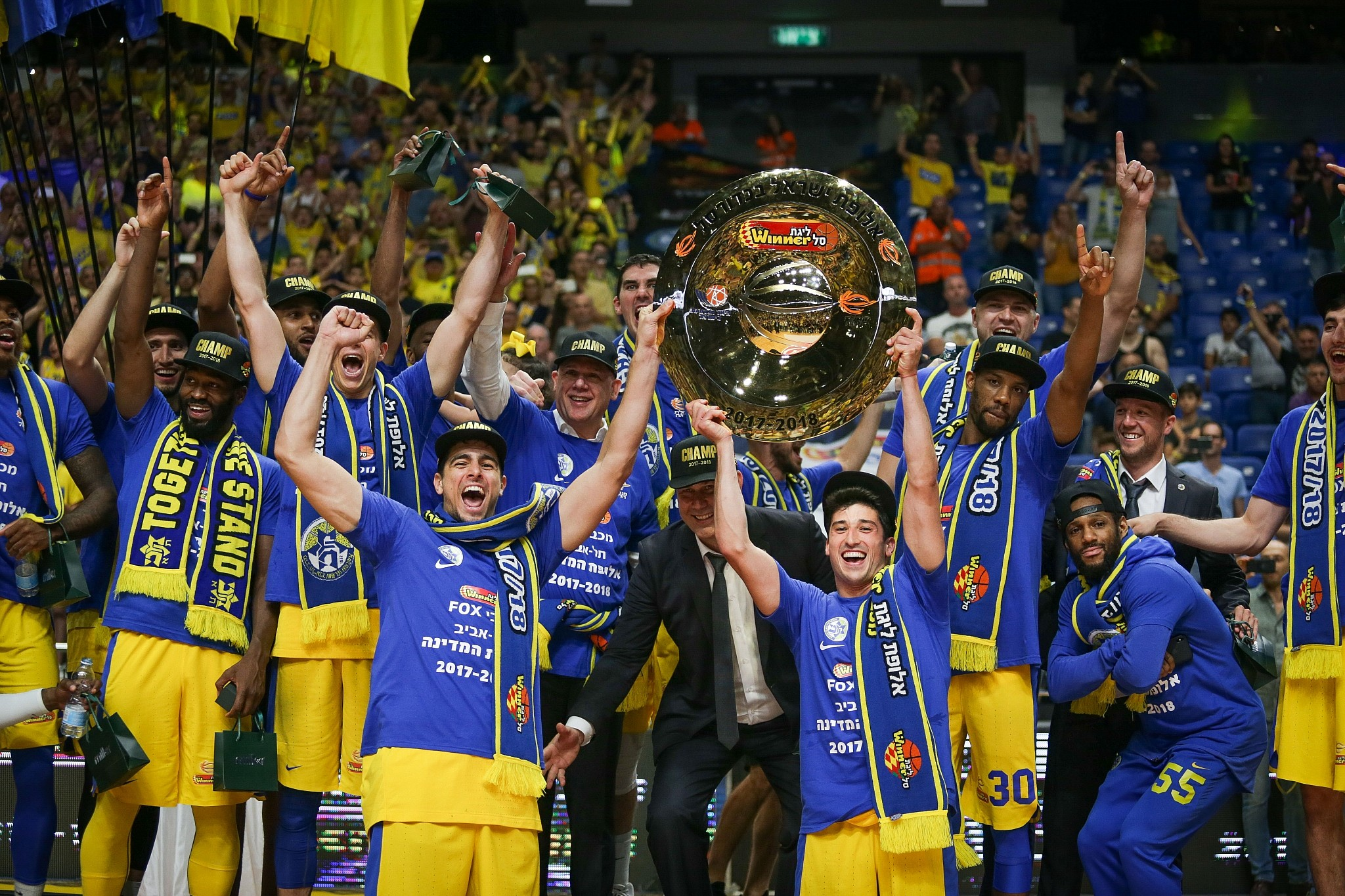 Maccabi Tel Aviv basketball team players raise the championship plate after  defeating Hapoel Holon at the f0c1c7677