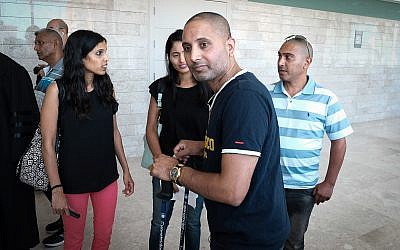 Niv Nehemia, who was seriously wounded in a stabbing attack at a supermarket in Yavne on August 2, 2017, arrives to hear the sentencing of the terrorist who stabbed him, given at  Lod District Court, on June 19, 2018. (Roy Alima/Flash90)