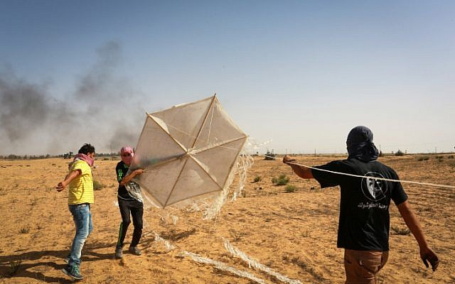 Palestinians prepare a kite with flammable materials that they will fly into southern Israel from Rafah, in the southern Gaza Strip, on June 22, 2018. (Abed Rahim Khatib/Flash90)