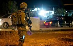 Illustrative. Israeli soldiers stand near the scene of a suspected car-ramming attack at the entrance to the village of Husan, in the West Bank, on June 23, 2018. (Flash90)