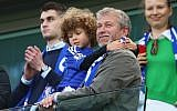 Chelsea owner Roman Abramovich looks on as Chelsea win the Premier League title after the Barclays Premier League match between Chelsea and Crystal Palace at Stamford Bridge on May 3, 2015 in London, England.  (Clive Mason/Getty Images via JTA)