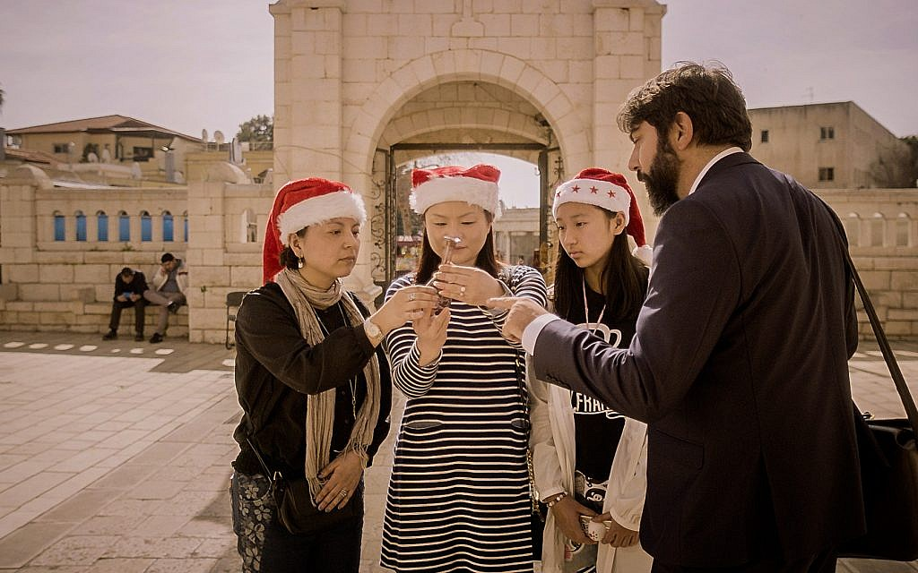 Shady Srour attempts to sell unique souvenirs to Christian tourists in 'Holy Air.' (© 2017 Tree M Productions)