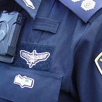 Illustrative image of a police officer wearing a body cam. (Israel Police)