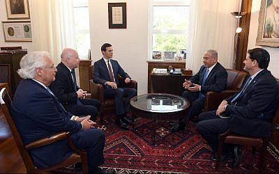 Prime Minister Benjamin Netanyahu (2nd from right) meets at his Jerusalem office with the ambassador to the US, Ron Dermer (right); White House adviser Jared Kushner (center); US Ambassador David Friedman (second left); and special envoy Jason Greenblatt, on June 22, 2018. (Haim Zach/GPO)