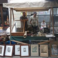 A stall selling Judaica and art at the Judafest street festival in Budapest, June 10, 2018. (Yaakov Schwartz/ Times of Israel)