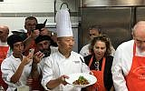 Chef David Lv displays his finished Yu Xiang eggplant dish at a workshop for Israeli chefs (Michael Harel/Times of  Israel)