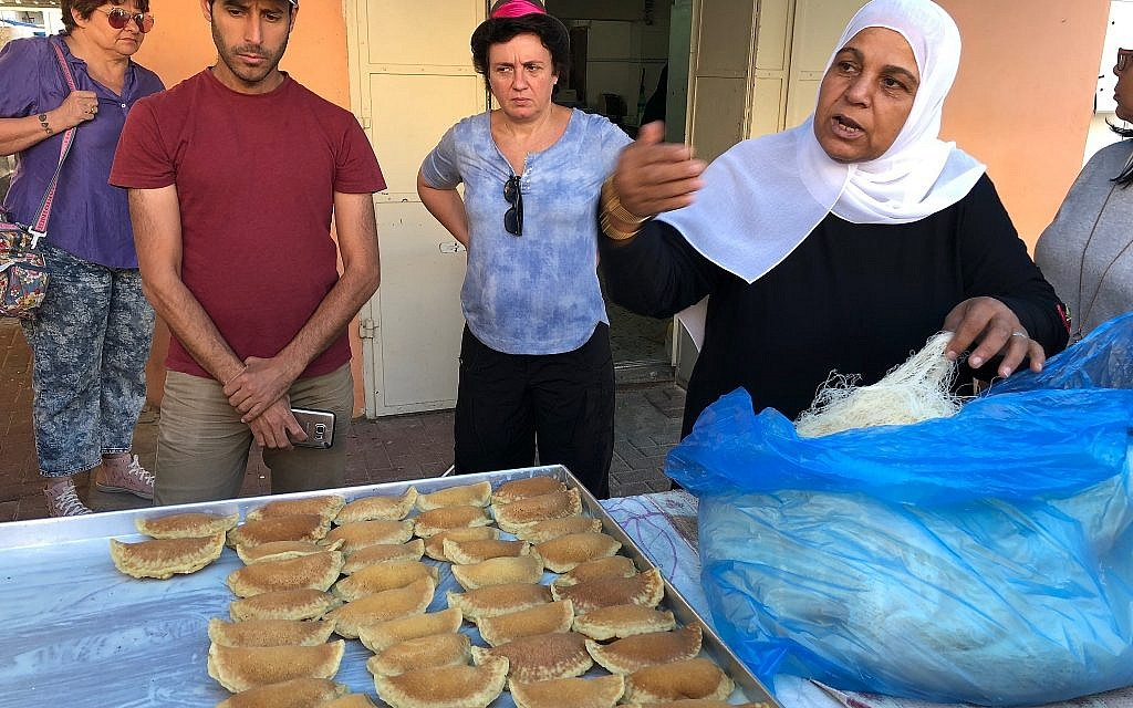 In Kafr Qara, Amna Kanana explains how to prepare traditional filled Ramadan sweets called katayif, June 2018. (Amanda Borschel-Dan/Times of Israel)
