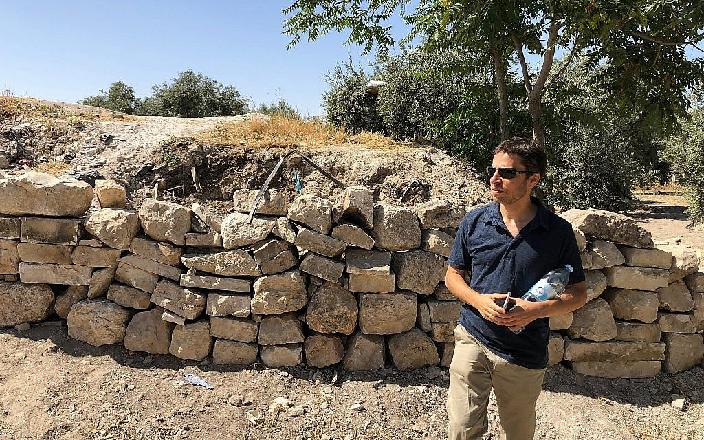 Archaeologist-activist Zachi Dvira examines what he said was damage to a mound of ancient dirt atop the Temple Mount, June 18, 2018. (Amanda Borschel-Dan/Times of Israel)