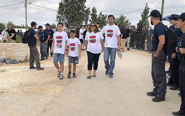 Residents of the Netiv Ha'avot outpost in the West Bank leave their home peacefully ahead of its court-ordered demolition, June 12, 2018. (Jacob Magid/The Times of Israel)