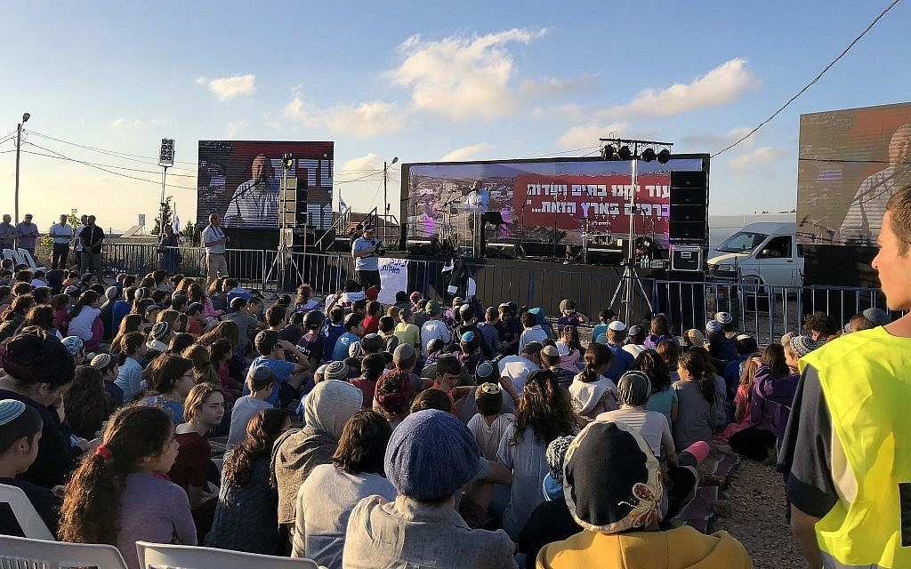 Some two thousand Israelis attend a protest rally at the West Bank outpost of Netiv Ha'avot on June 11, 2018, ahead of its scheduled demolition. (Jacob Magid/Times of Israel)