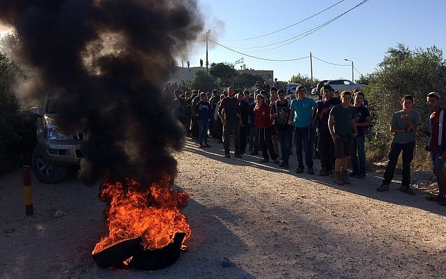 Protesters at the Netiv Ha'avot outpost in the Gush Etzion area of the West Bank shortly before the expected demolition of 15 homes built illegally on private Palestinian land, on June 12, 2018. (Luke Tress/Times of Israel)