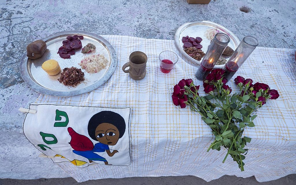 A seder plate setting at the Juneteenth seder put on by JFREJ, held alongside the East River in New York City on June 14, 2018. (Rafael Shimunov)