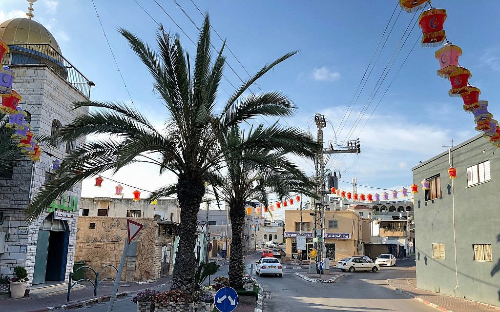 Downtown Kafr Qara, decorated for Ramadan, June 2018. (Amanda Borschel-Dan/Times of Israel)