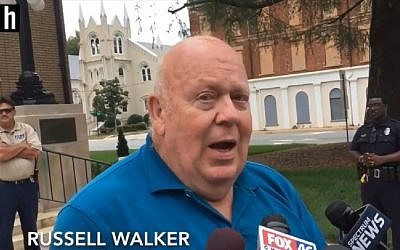 """Russell Walker, a Republican candidate in North Carolina, wrote on his website that God is a """"racist white supremacist"""" and that Jewish people are Satanic. (Screen capture: Raleigh-based News & Observer)"""