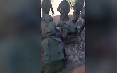 Screen capture from video allegedly showing IDF soldiers attending to injured Palestinian man Azzedine Tamimi who shot by troops in the West Bank village of Nebi Saleh, June 6, 2018. (YouTube)