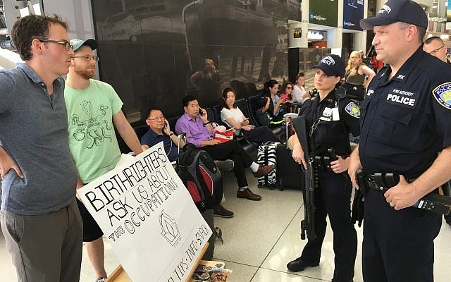 Port Authority tells IfNotNow members that they must desist from engaging Birthright participants if they do not have a permit, at New York's JFK airport, Monday, June 18, 2018. (Steven Davidson/ Times of Israel)