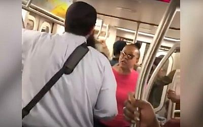 A screenshot from a video of Shauntaye King yelling at Yossi Wolfe on a New York City subway car. (Screen capture: YouTube)