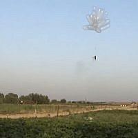 Incendiary balloons being launched into Israel from the Gaza Strip in May 2018. (Screen capture: Quds news)