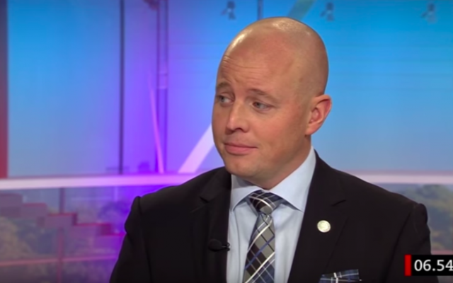 Bjorn Soder, who represents the Sweden Democrats party in parliament, speaks in a TV interview on December 16, 2014. (screen capture: YouTube)
