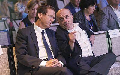 Then-outgoing Jewish Agency chairman Natan Sharansky and chairman-elect Isaac Herzog following Herzog's election at the Jewish Agency Board of Governors meeting in Jerusalem, June 24, 2018. (Nir Kafri for The Jewish Agency for Israel/courtesy)