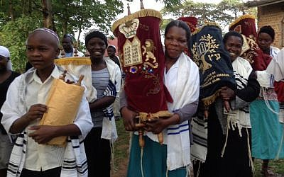 Jewish Ugandan women carry Torah scrolls in Nabagoye, Uganda (Courtesy of Be'chol Lashon)