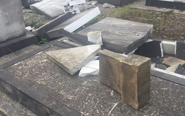 Smashed headstones at the Urmston Jewish Cemetery in Manchester, Britain. (Twitter/@Joanne13Harding)
