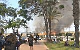 Students at Sderot's Sapir College watch as a large fire breaks out near Kibbutz Nir Am in southern Israel, which was apparently caused by a 'fire kite' from the Gaza Strip, on June 5, 2018. (Tair Alush)