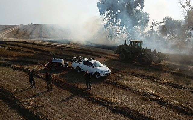 Israeli authorities respond to a fire in a field in the Eshkol region of southern Israel on June 5, 2018. (Eshkol regional council)