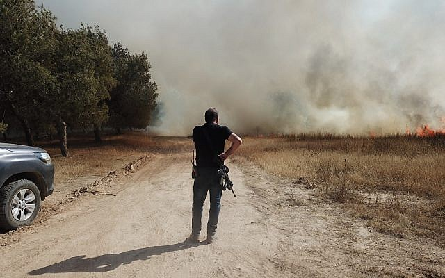 An Eshkol region security officer responds to a fire in a field in southern Israel on June 5, 2018. (Eshkol regional council)