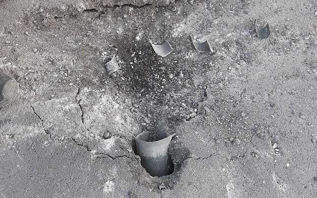 A rocket fired from Gaza that landed in a street in one of the communities of the Eshkol region on June 20, 2018. (Eshkol region)