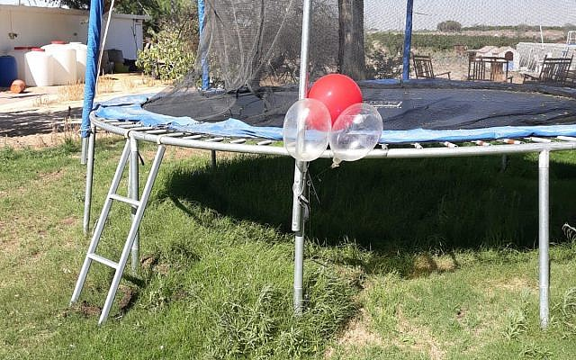 A cluster of balloons with a small explosive device attached to them, which landed and got stuck on a trampoline in a backyard in the Eshkol region of southern Israel on June 20, 2018. (Eshkol Security)