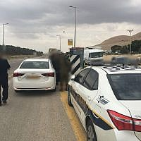Illustative: Israel Police pull over a vehicle in the West Bank on June 20, 2018. (Israel Police)