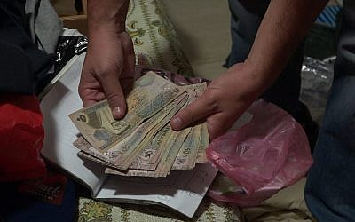 Cash seized on June 27, 2018, in a raid on the home of the family of Alaa Abu Dheim, who perpetrated the 2008 terror attack on Mercaz Harav yeshiva. (Israel Police)