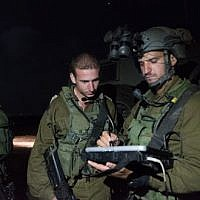 IDF officers on the Golan Heights managing an operation on June 28, 2018 to provide humanitarian aid to Syrian refugees in tent encampments in southwestern Syria. (IDF Spokesperson's Unit)