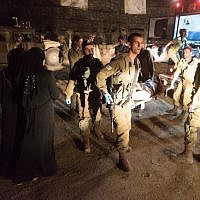 Israeli army medics bring injured Syrian nationals into Israel for medical treatment on June 29, 2018. (Israel Defense Forces)