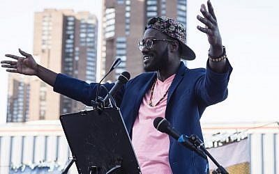 Yehuda Webster speaks at the Juneteenth seder put on by JFREJ, held alongside the East River in New York City on June 14, 2018. (Rafael Shimunov)