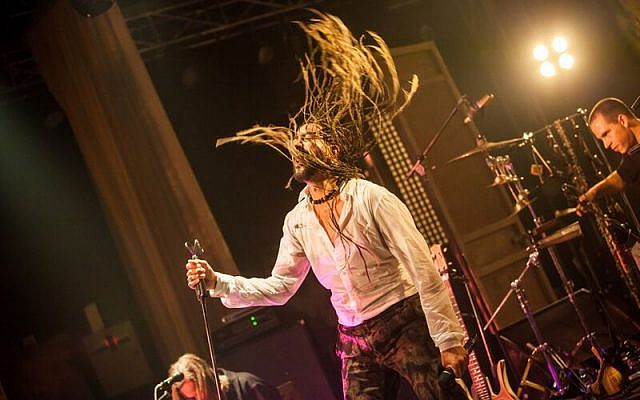 Yemen Blues founder Ravid Kahalani swings his long braids onstage. (Courtesy)