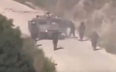 Hezbollah gunmen converge on a stricken IDF Humvee during July 2006 attack (YouTube screenshot)