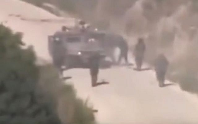 Hezbollah gunmen converge on a stricken IDF Humvee during July 2006 attack (YouTube screenshot)