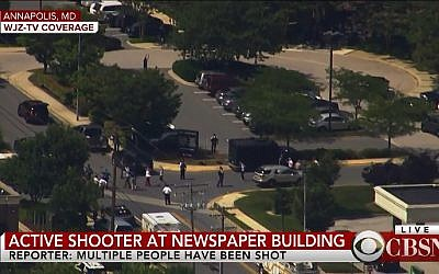 People leave the building of The Capital newspaper in Annapolis, Maryland after shooting on June 28, 2018. (Screen capture: CBSN)