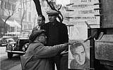 A man buying Jewish newspapers from a stall in Buenos Aires, circa 1956. (Evans/Three Lions/Getty Images)