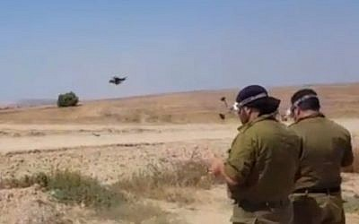 Air force reservists use drones to identify and shoot down incoming balloons and kites from Gaza that are fitted with flammable materials to set Israeli fields on fire, June 7, 2018. (Hadashot News screenshot)