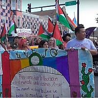 Participants in the 2018 Chicago Dyke March waving Palestinian flags. (Screen capture: Windy City Times)