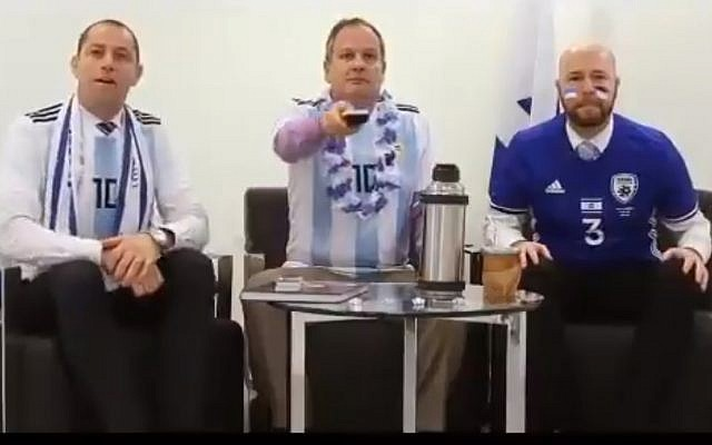 Israeli ambassador to Argentina, Ilan Sztulman, (C) and friends get ready to root for Lionel Messi's team in a humorous video clip  made for the World Cup opening on June 14, 2018