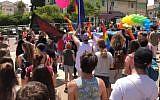 Participants in Kfar Saba's inaugural Gay Pride Parade on June 1, 2018. (Screen capture: Ynet news)
