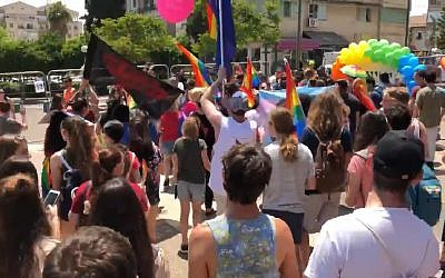 Participants in Kfar Saba's inaugural Gay Pride Parade on June 1, 2018. (Screen capture: Ynet news)