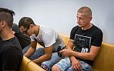 Andrei Case (R) and Peter Guskov (L) former employees of a nursing home in Haifa who were sentenced for abusing the elderly at a nursing home, seen at the Haifa District Court on June 7, 2018. (Flash90)