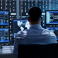 'Israel's Technology Economy, Origins and Impact' by David Rosenberg takes a hard look at Israel's startup industry and its impact -- good and bad, on the nation's economy; Illustrative image of a system security specialist at work (gorodenkoff; iStock by Getty Images)