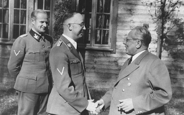 SS chief Heinrich Himmler (center) shakes hands with Hitler's photographer, Heinrich Hoffmann, around 1941 (public domain)