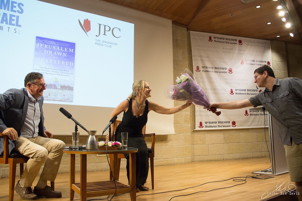 Author Sarah Tuttle-Singer is presented with flowers at a Times of Israel  Presents event in Jerusalem, June 18, 2018. (Laura Ben-David)